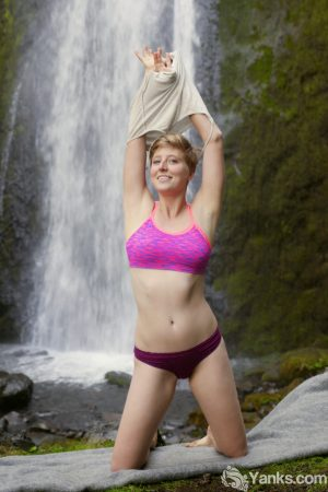 Short haired amateur Aurora Odaire gets naked in front of a waterfall