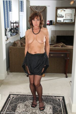 Mature wife Lynn showing off her saggy boobs & spread ass in black stockings