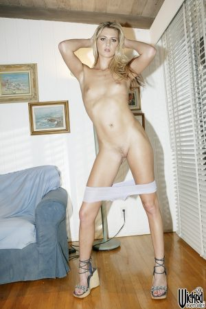 Blonde MILF Ashley Long strips naked to show her skinny body & her tiny tits