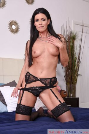 White lady India Summer removes her dress for nude poses in black nylons