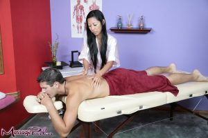 Oriental masseuse Tia Ling stripping naked for happy ending handjob