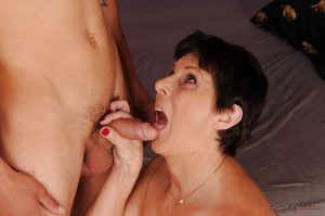 Chubby mature lady in lingerie and stockings gets slammed by a younger guy