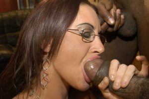 Busty girl Emma Butt gets gangbanged by big black dicks with her glasses on