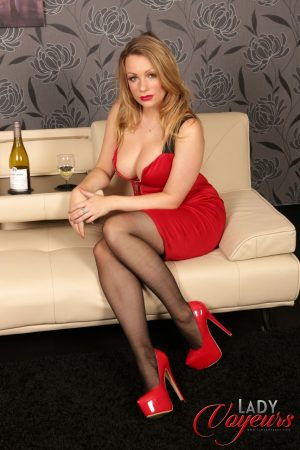 Stunning wife in a red dress Penny Lee reveals her pink undies & hot stockings