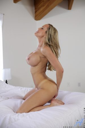Buxom MILF with great legs undressing for masturbation of pierced pussy
