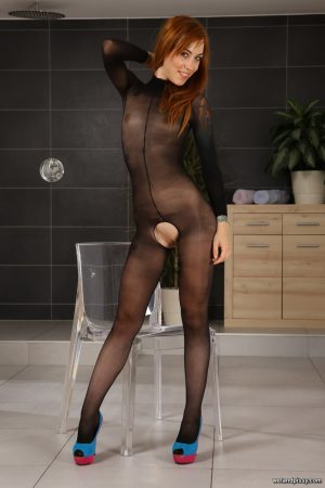 Alluring redhead Foxie T plays solo water sport games in crotchless pantyhose