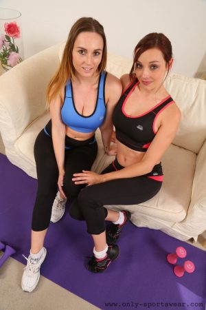 Sexy exercise buddies Harper and Jo E posing topless together in hot leggings