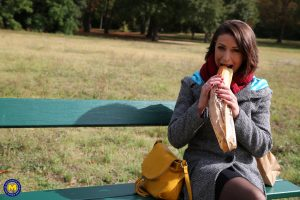 French mom Anya flashes her legs in stockings while eating a sandwich outside