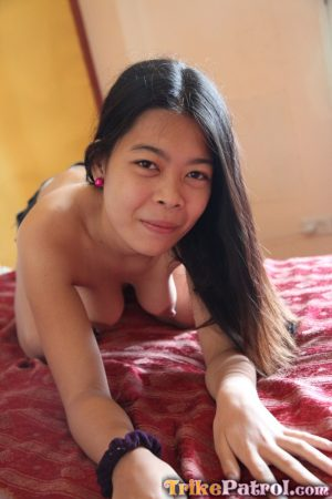 Filipina girl Marie stands naked after removing her clothes for the first time