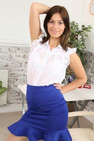 Slender brunette Summer drops her blue skirt & teases in nylons & white undies
