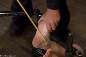 Hot skinny MILF Bobbi Starr gets tied and abused on the dungeon floor