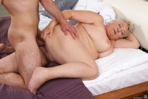 Fat old woman with short and her young lover experiment with hardcore sex