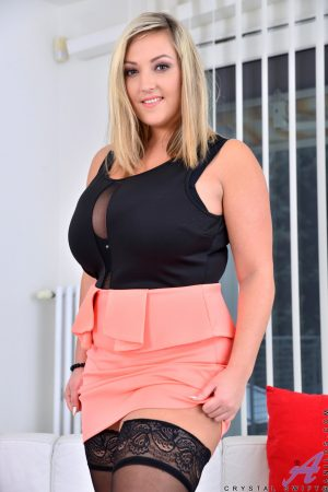 Chubby amateur MILF Crystal Swift shows her large natural tits and round ass