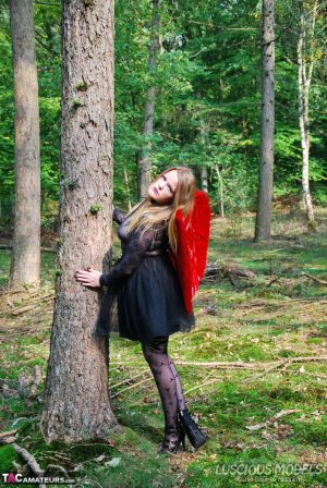 Amateur woman Luscious Models poses in the forest in a cosplay clothing