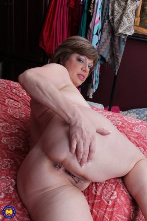 Big titted mature Piper C sucks her hard nipples and masturbates with a toy