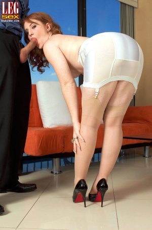 Pale redhead Lucy Fire sheds vintage lingerie and nylons before fucking