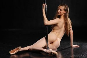 Acrobatic Annett A spreads long legs naked to pole dance showing bald muff
