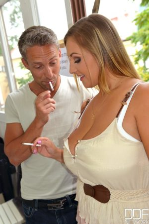 Czech MILF Krystal Swift lets out her massive breasts and gives a titjob