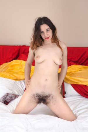 Chesty brunette Aragne spreading her hairy pussy to show her sweet interior