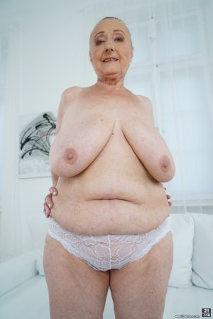 Very old granny Sila lets those massive naturals out and poses naked 1