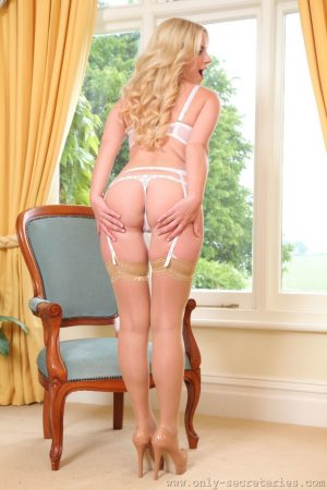 Cute blonde Billie doffs her blue and grey dress to tease with perfect bosom