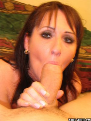 Mature brunette in sexy lingerie Anya Cox gets on her knees for a blowjob