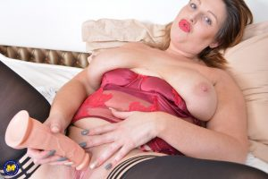 Busty mature fatty in red lingerie licking her nipples with her pierced tongue