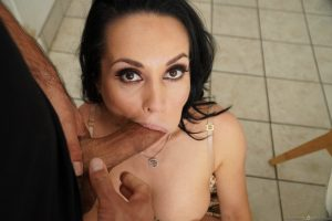 Salacious cougar Crystal Rush reveals her hot boobs before giving a blowjob