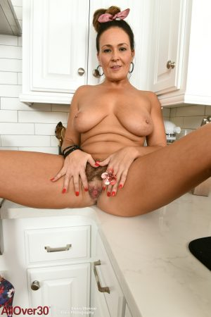 Alluring MILF Elexis Monroe strips to show her natural tits & hairy pussy