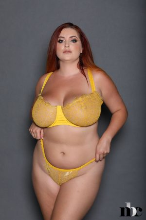 Alluring British vixen Lucy Vixen teasing with her shapely body & big tits