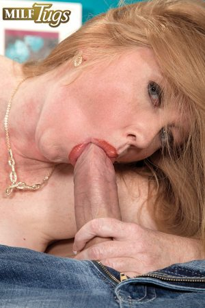 Guy mouthfucks mature blonde woman with big boobs and cums on her face
