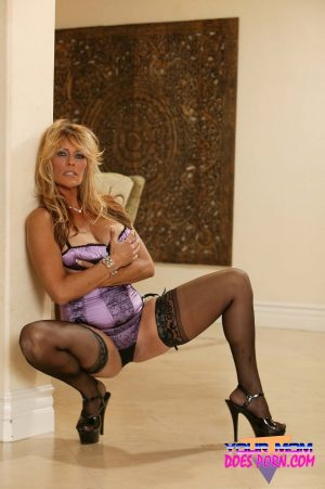 Tall American mature Debbie Diamond cuddles herself & poses in sexy stockings