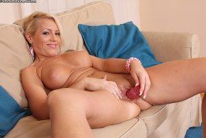 Big busted blonde MILF Sarah Simon toying her shaved twat