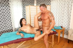 Asian massage parlor worker Saya Song takes a cumshot on bush from a client