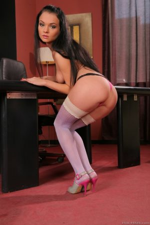 Slender alluring Anabell flaunts her tiny ass in stockings on the office desk
