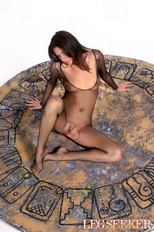 Sultry brunette Gabriella toys her trimmed pussy in crotchless bodystocking
