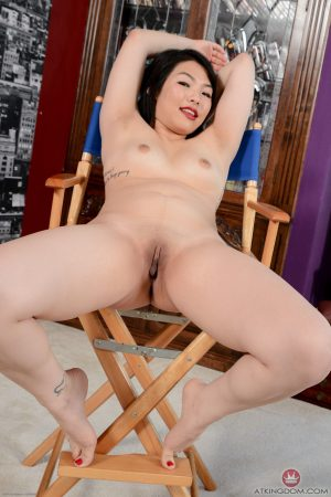 Asian teen Nari Park exposes her body and flaunts her twat on a folding chair