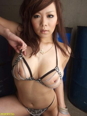 Brunette Asian girl Ren Mizumori strips and plays with a rubber toy before sex