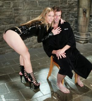 Dominant cougar Harmony has fun with obedient man locked in small cage