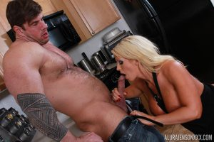 Blonde housewife Alura Jenson holds her big boobs for jizz after kitchen sex