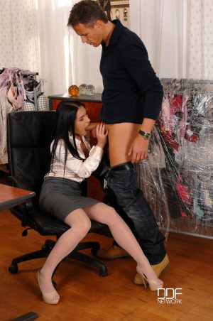 Lusty secretary Honey Demon takes a rod in her mouth while rubbing her twat