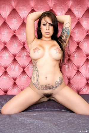 Hot Latina chick Tori Avano bares her tattooed boobs before sucking off a cock
