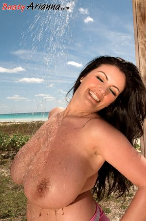 Fatty Romanian MILF Arianna Sinn washes and squeezes her large melons outside