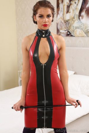 Dirty chick Zoey King removes her latex dress and poses topless in undies