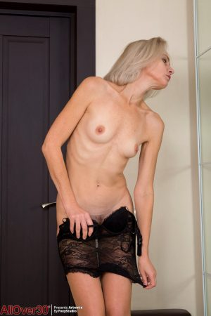 Skinny mature beauty Artemia disrobing and spreading pussy lips close up