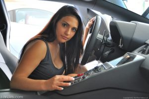 Brunette beauty Rikki exposes her hot boobs and presses them on a car hood