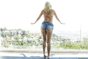 Blonde babe with a perfect ass Layla Price shows off outdoor