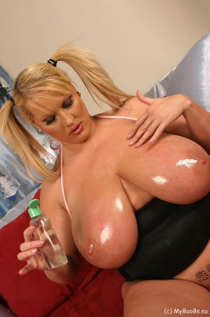 Blonde BBW Laura M plays with her snatch after oiling up her giant breasts