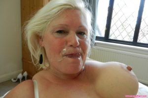 Fat blonde granny Lacey Starr gets blacked from behind and enjoys a facial