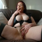 Older British lady Juicey Janey smokes while showing her big tits and snatch